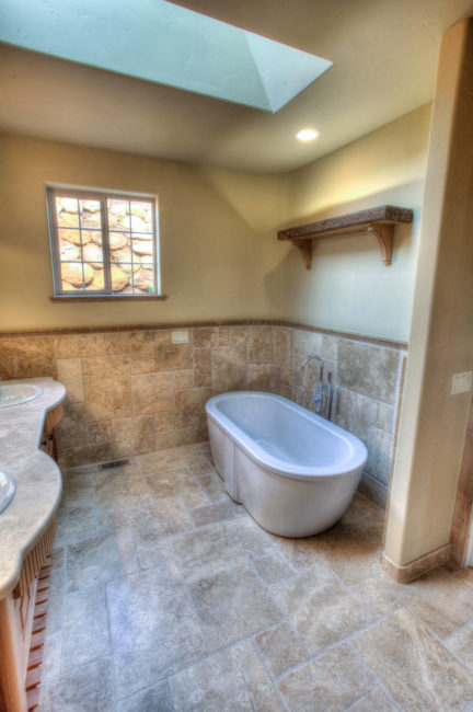 A free-standing soaker tub brings a modern twist to this classic master bath.