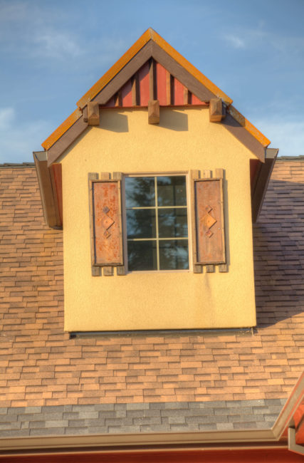 A stucco dormer with details!